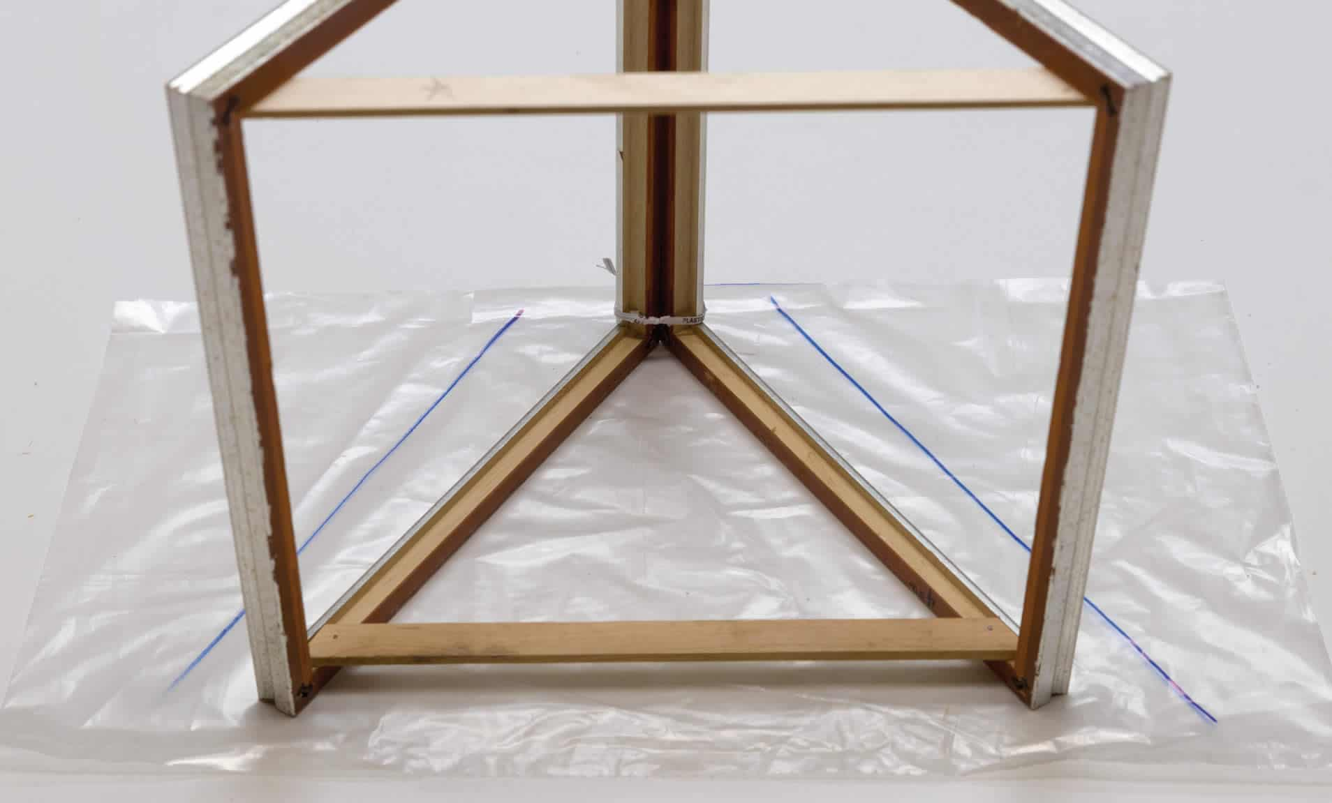 Step 5d-mini indoor greenhouse-Cut the two pieces of plastic that will fit the triangle shapes on each side