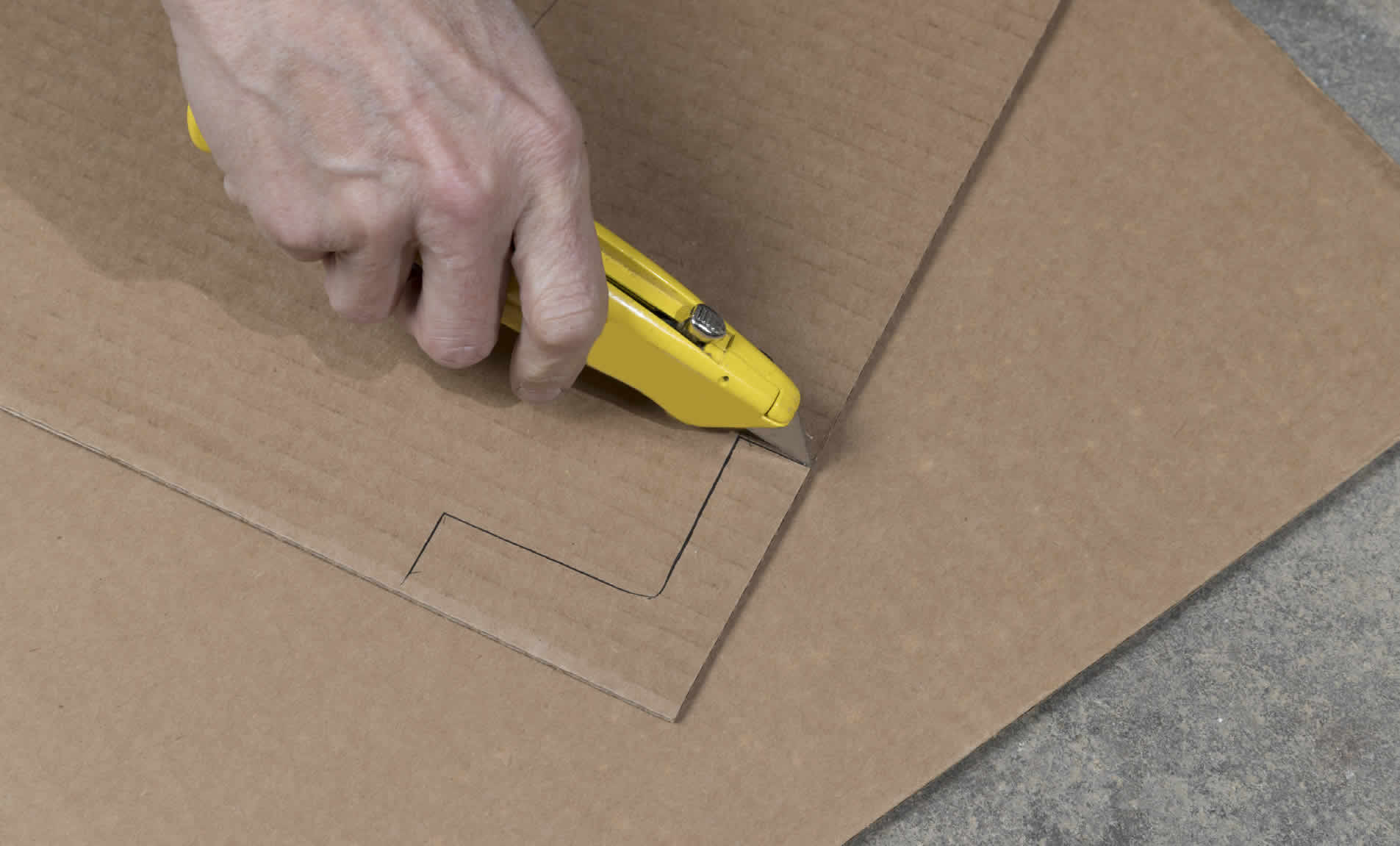 cutting cardboard with a box cutter